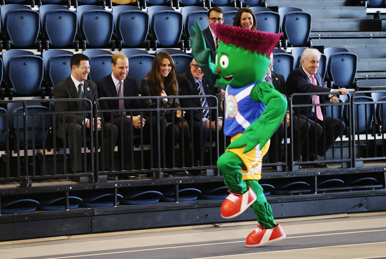 GLASGOW, UNITED KINGDOM - APRIL 04:  Prince William, Earl of Strahearn and Catherine, Countess of Strathearn look on as 2014 Glasgow Commonwealth Games mascot Clyde runs around the track during their visit to the Emirates Arena on April 4, 2013 in Glasgow, Scotland. The Emirates Arena will play host to several events at the 2014 Glasgow Commonwealth Games.  (Photo by Chris Jackson/Getty Images)