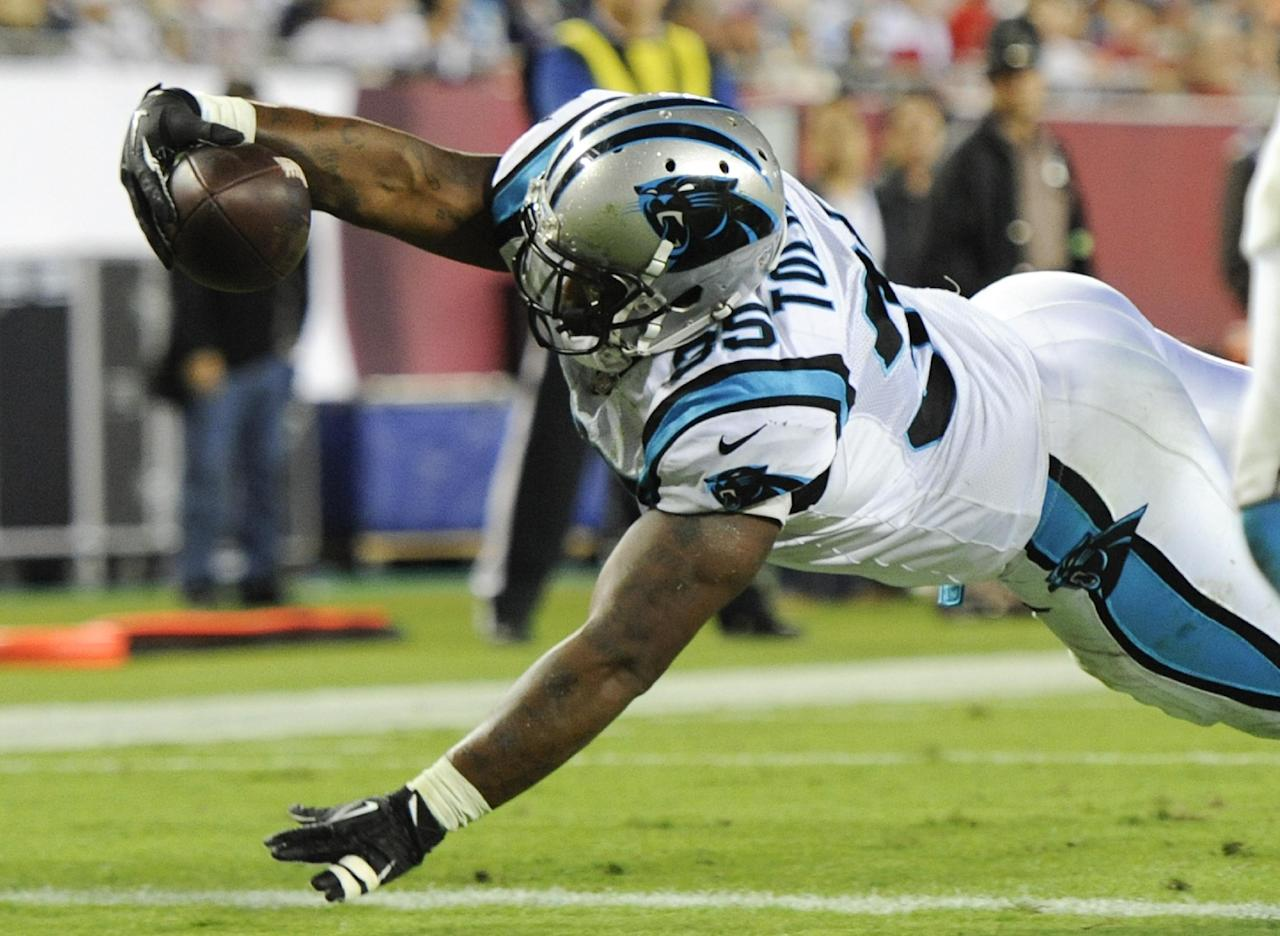 Carolina Panthers fullback Mike Tolbert dives over the goal line on a 3-yard touchdown pass play against the Tampa Bay Buccaneers during the second half of an NFL football game in Tampa, Fla., Thursday, Oct. 24, 2013. (AP Photo/Brian Blanco)