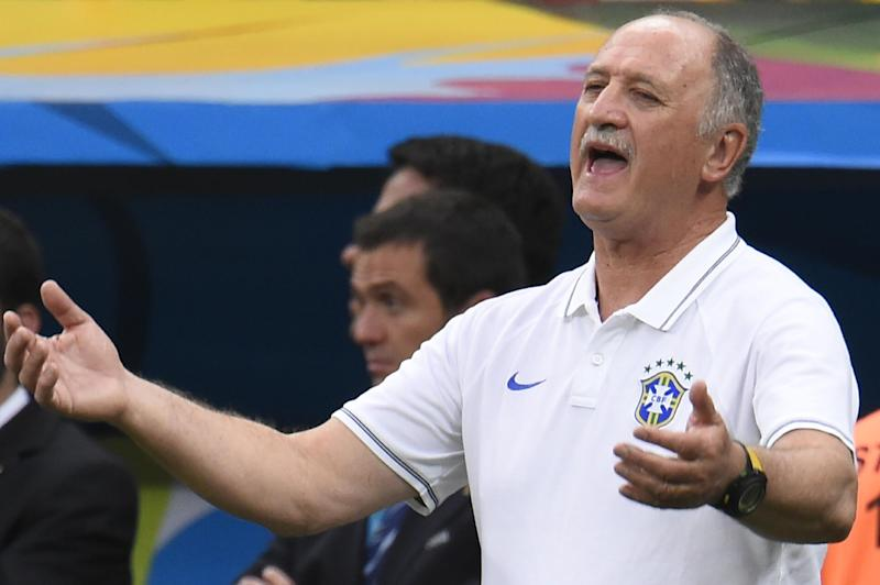 Local media reports say Brazil's coach Luiz Felipe Scolari, shown here during a match against the Netherlands on July 12, 2014, has been fired