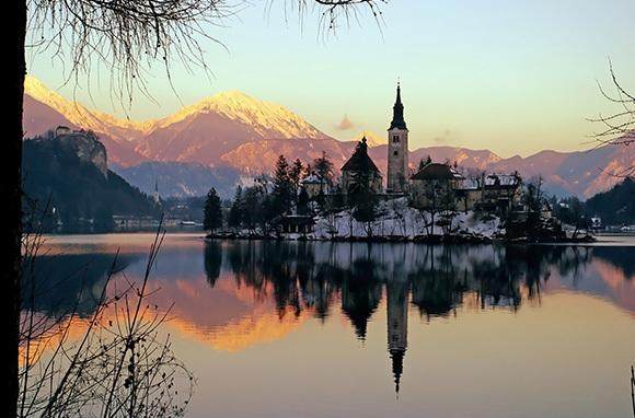 """<div class=""""caption-credit""""> Photo by: Smarter Travel</div><div class=""""caption-title"""">Lake Bled, Slovenia</div>Be transported to a medieval world during your trip to the Slovenia waterfront. <br> <i>Find out more at <a rel=""""nofollow"""" target=""""_blank"""" href=""""http://www.smartertravel.com/photo-galleries/editorial/stunning-places-to-see-sunsets-around-the-world.html?id=169&photo=25040"""">Smarter Travel.</a></i> <br> <i><b>MORE ON BABBLE</b> <br> <a rel=""""nofollow"""" target="""""""" href=""""http://www.babble.com/family-style/2012/08/30/10-quirkiest-hotels-in-the-world/?cmp=ELP%7Cbbl%7Clp%7CYahooShine%7CMain%7C%7C041913%7C%7C25PlacestoSeetheMostBeautifulSunset%7CfamE%7C%7C%7C"""">The 10 strangest hotels you'll ever stay at</a> <br> <a rel=""""nofollow"""" target="""""""" href=""""http://www.babble.com/family-style/2012/02/01/25-amazingly-tiny-houses/?cmp=ELP%7Cbbl%7Clp%7CYahooShine%7CMain%7C%7C041913%7C%7C25PlacestoSeetheMostBeautifulSunset%7CfamE%7C%7C%7C"""">25 insanely tiny houses</a></i><i><br></i> <br> <i><a rel=""""nofollow"""" target=""""_blank"""" href=""""http://www.smartertravel.com/photo-galleries/editorial/stunning-places-to-see-sunsets-around-the-world.html?id=169&photo=25040""""></a></i>"""