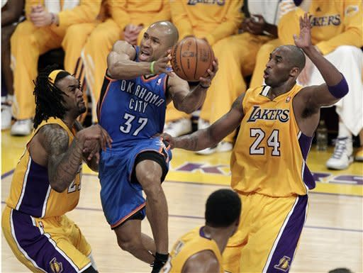 Oklahoma City Thunder's Derek Fisher, center, goes up for a basket against Los Angeles Lakers' Kobe Bryant, right, and Jordan Hill during the second half in Game 3 of an NBA basketball playoffs Western Conference semifinal in Los Angeles, Friday, May 18, 2012. (AP Photo/Jae C. Hong)