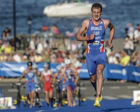 Britain's Alistair Brownlee runs on his way to winning the ITU World Triathlon elite race for men in Stockholm City