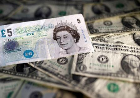 Dollar edges up, on track for weekly gain, quarterly loss