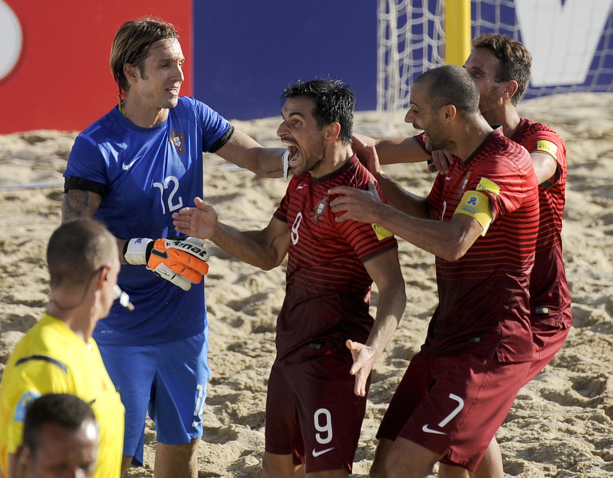 Portugal's Bruno Novo, second left, celebrates with teammates after scoring during their FIFA Beach Soccer World Cup final match in Espinho, Portugal, Sunday, July 19, 2015. Portugal beat Tahiti 5-3 to win the Beach Soccer World Cup.(AP Photo/Paulo Duarte)