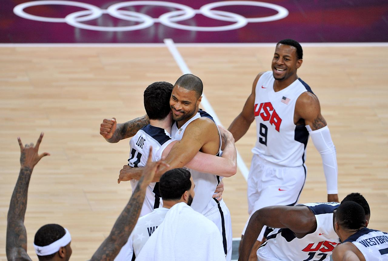 LONDON, ENGLAND - AUGUST 12:  Team mates Chris Paul #13 of the United States and Tyson Chandler #4 of the United States celebrate winning the Men's Basketball gold medal game between the United States and Spain on Day 16 of the London 2012 Olympics Games at North Greenwich Arena on August 12, 2012 in London, England. The United States won the match 107-100.  (Photo by Pascal Le Segretain/Getty Images)