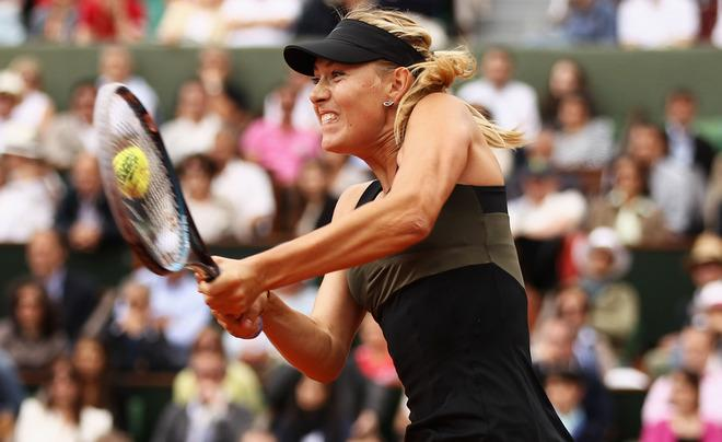 PARIS, FRANCE - JUNE 09:  Maria Sharapova of Russia plays a backhand in the women's singles final against Sara Errani of Italy during day 14 of the French Open at Roland Garros on June 9, 2012 in Paris, France.  (Photo by Matthew Stockman/Getty Images)