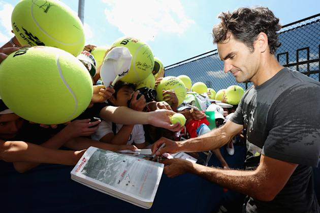 Federer signs autographs after practice Thursday at the U.S. Open (Photo by Mike Stobe/Getty Images for USTA)