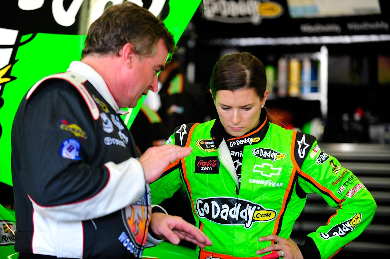 CONCORD, NC - MAY 24:  Joe Nemechek (L), driver of the #87 AMFMEnergy.com/Pellet & Wood Stoves Toyota, talks with Danica Patrick (R), driver of the #7 GoDaddy.com Chevrolet, in the garage area during practice for the NASCAR Nationwide Series History 300 at Charlotte Motor Speedway on May 24, 2012 in Concord, North Carolina.  (Photo by Jamey Price/Getty Images for NASCAR)