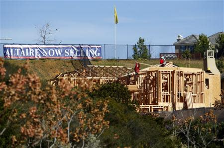Workers build a new single-family home in San Marcos, California