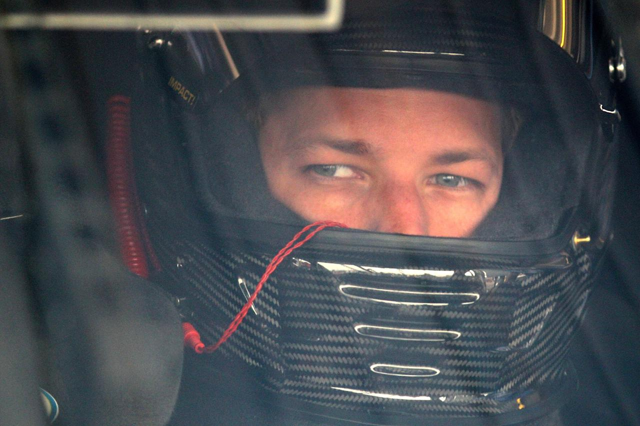 AVONDALE, AZ - NOVEMBER 11: Brad Keselowski, driver of the #2 Miller Lite Dodge, sits in his car during practice for the NASCAR Sprint Cup Series Kobalt Tools 500 at Phoenix International Raceway on November 11, 2011 in Avondale, Arizona.  (Photo by Christian Petersen/Getty Images)