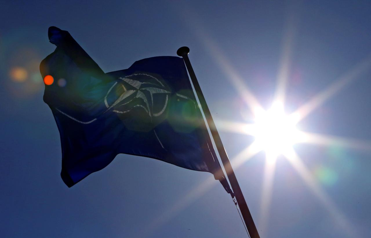 FILE PHOTO - A NATO flag flies at the Alliance's headquarters in Brussels, March 2, 2014.  REUTERS/Yves Herman/File Photo     TPX IMAGES OF THE DAY
