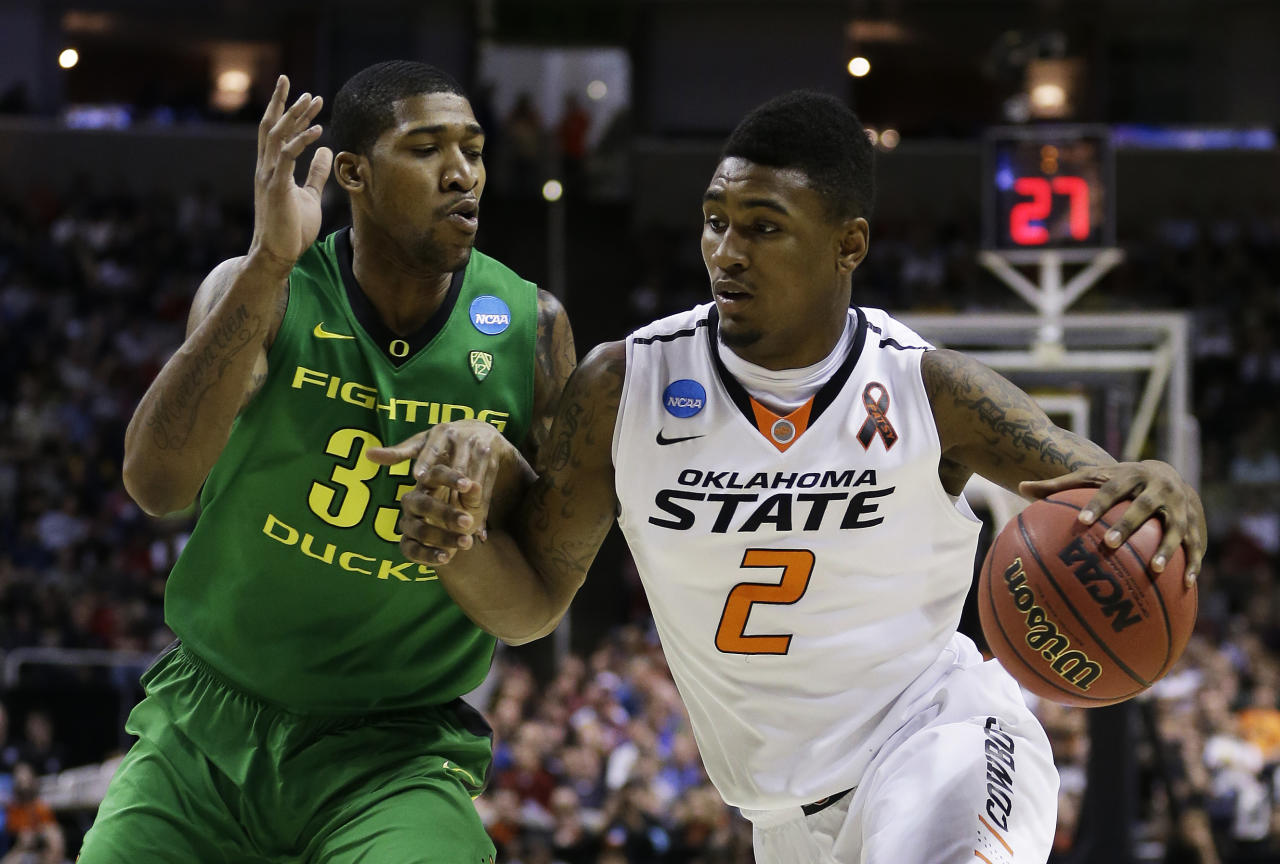 SAN JOSE, CA - MARCH 21:  Le'Bryan Nash #2 of the Oklahoma State Cowboys drives against Carlos Emory #33 of the Oregon Ducks in the first half during the second round of the 2013 NCAA Men's Basketball Tournament at HP Pavilion on March 21, 2013 in San Jose, California.  (Photo by Ezra Shaw/Getty Images)