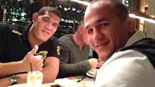 Antonio Silva and Junior dos Santos pose for a picture during a dinner. (Yahoo)