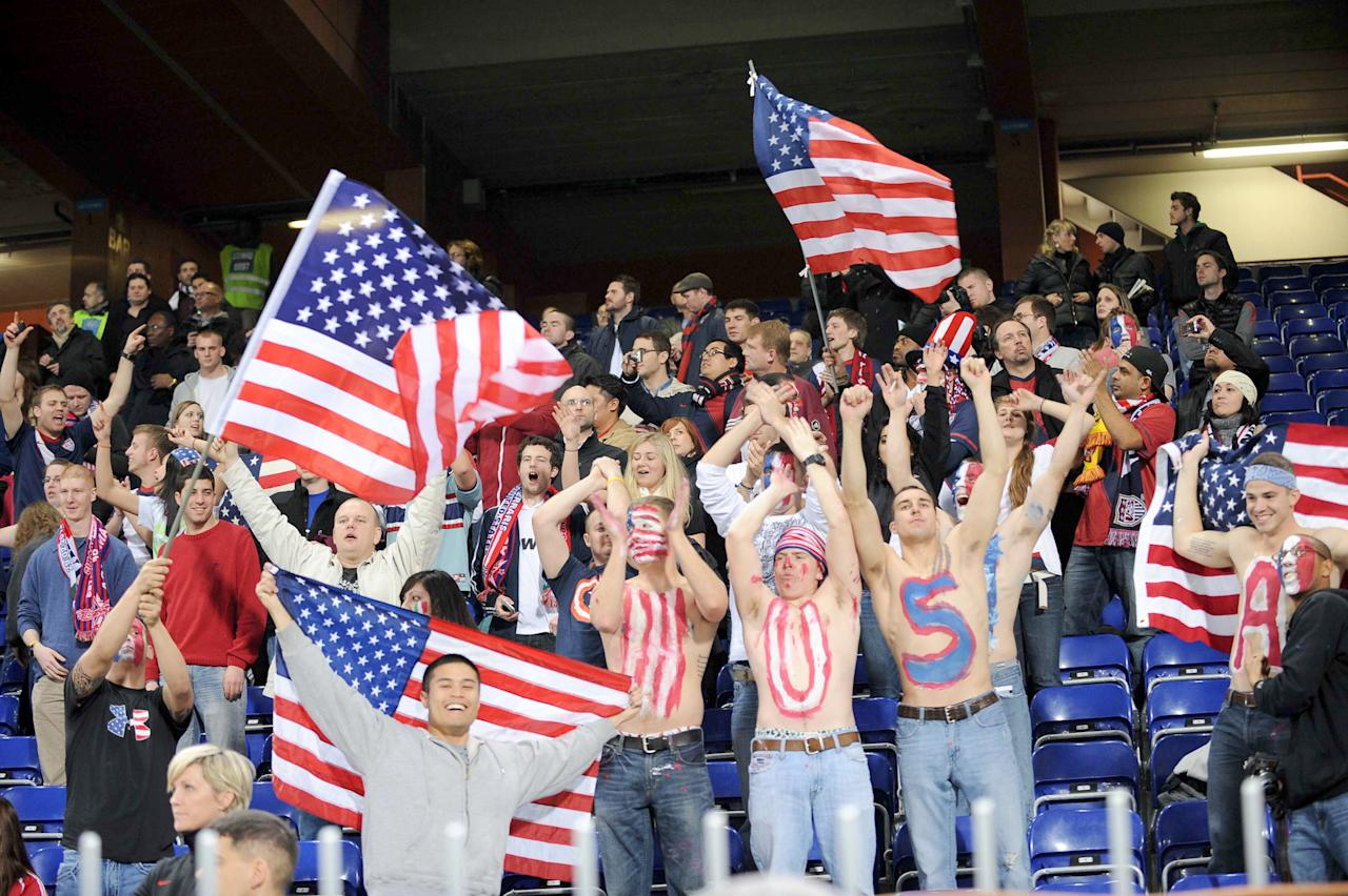 US supporters celebrate at the end of a friendly soccer match between Italy and USA, at the Genoa Luigi Ferraris stadium, Italy, Wednesday, Feb. 29, 2012. USA won 1-0. (AP Photo/Tanopress)