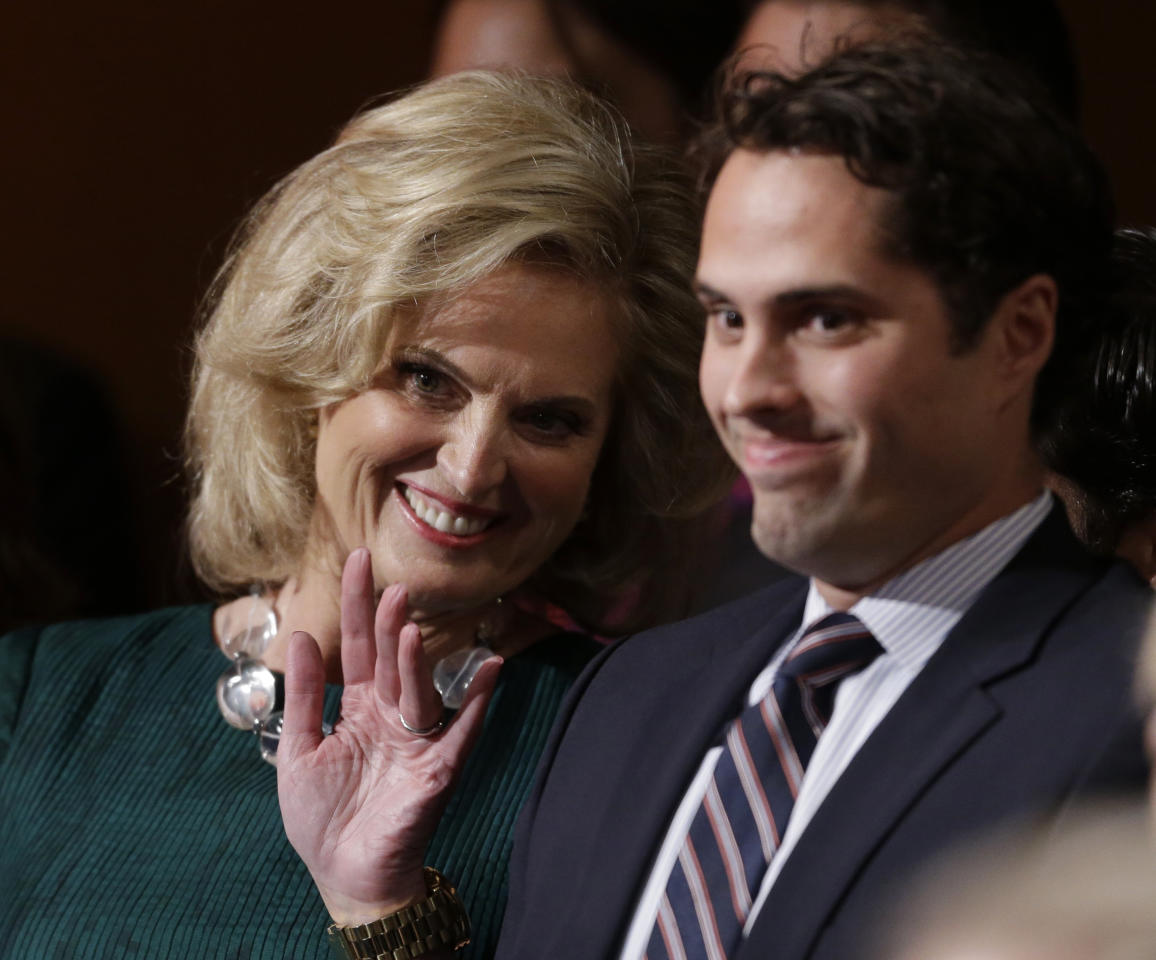 Ann Romney, seated next to her son Craig, waves to audience members before the third presidential debate between President Barack Obama and Republican presidential nominee Mitt Romney at Lynn University, Monday, Oct. 22, 2012, in Boca Raton, Fla. (AP Photo/David Goldman)