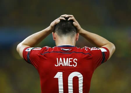 Colombia's James Rodriguez reacts after missing a goal scoring opportunity against Brazil during their 2014 World Cup quarter-finals at the Castelao arena in Fortaleza
