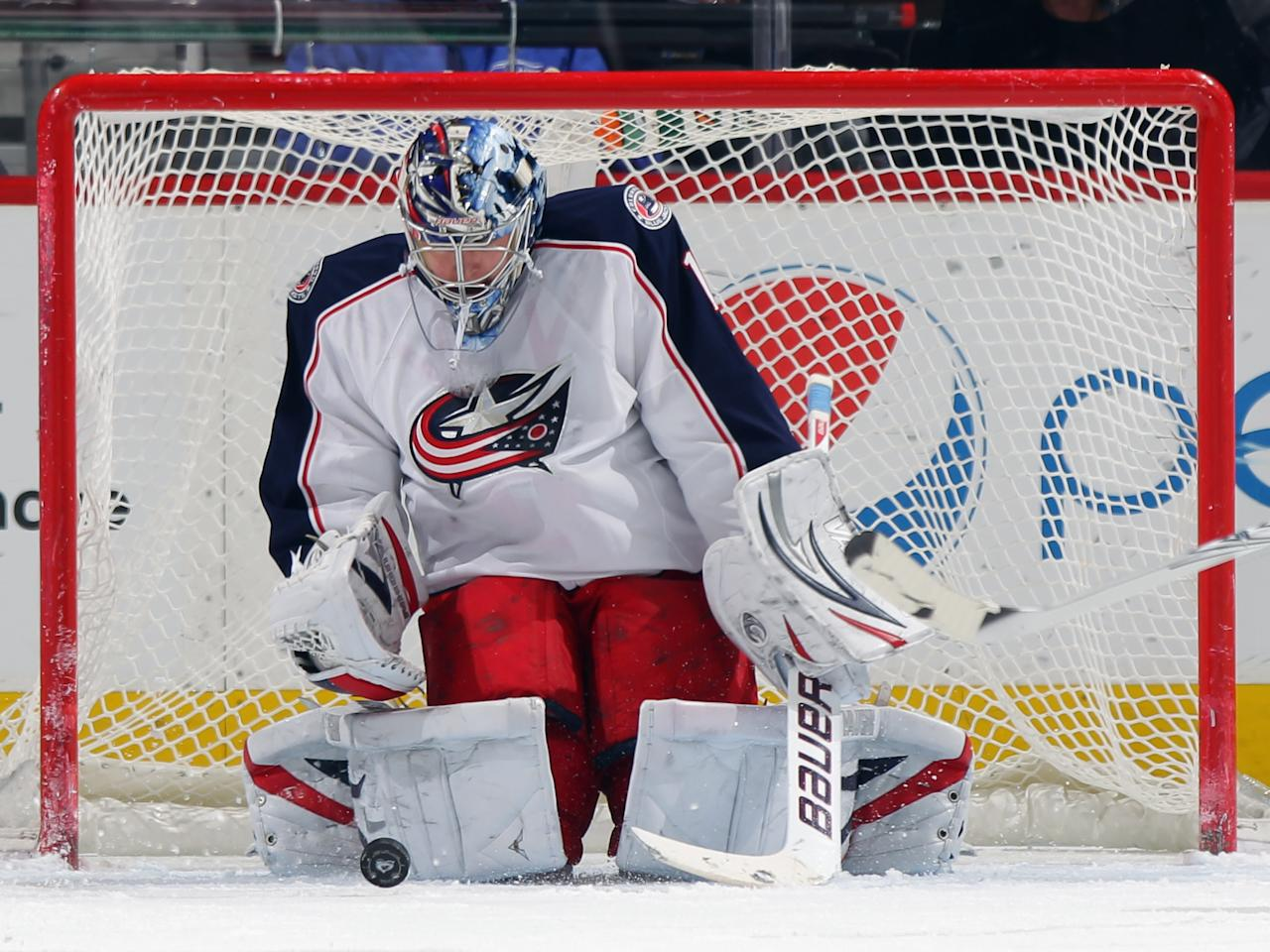 DENVER, CO - MARCH 01:  Goalie Steve Mason #1 of the Columbus Blue Jackets makes a save against the Colorado Avalanche at the Pepsi Center on March 1, 2012 in Denver, Colorado. Mason had 33 saves as he shut out the Avalanche 2-0.  (Photo by Doug Pensinger/Getty Images)