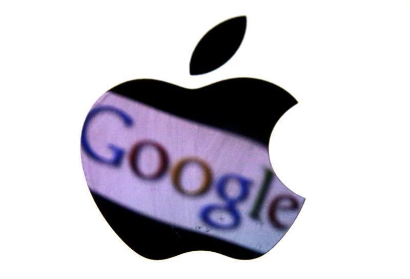 A Google trademark is reflected in Apple logo in this photo illustration taken in Berlin