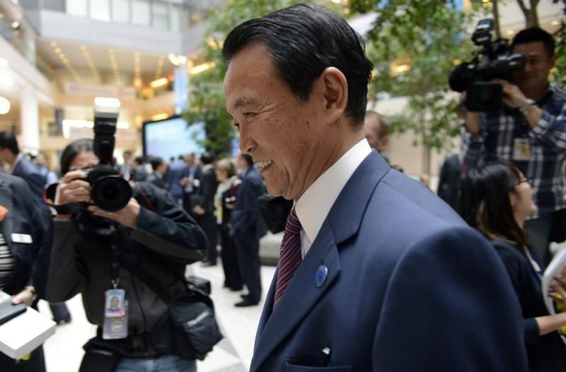 Japan's Finance Minister Aso arrives for the start of the G20 ministerial meetings, during the IMF/World Bank's 2014 Spring Meetings in Washington