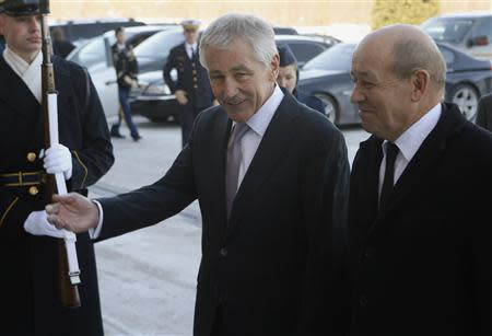 U.S. Secretary of Defense Hagel welcomes French Minister of Defense Le Drian before their meeting at the Pentagon in Washington