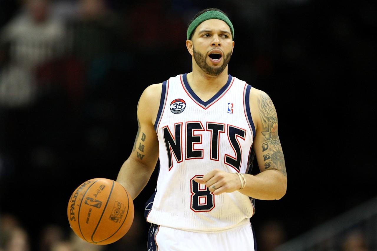 NEWARK, NJ - APRIL 10:  Deron Williams #8 of the New Jersey Nets brings the ball up court in the second half against the Philadelphia 76ers at Prudential Center on April 10, 2012 in Newark, New Jersey.  NOTE TO USER: User expressly acknowledges and agrees that, by downloading and or using this photograph, User is consenting to the terms and conditions of the Getty Images License Agreement.  (Photo by Chris Chambers/Getty Images)