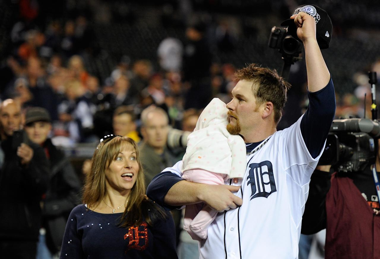 DETROIT, MI - OCTOBER 18:  Phil Coke #40 of the Detroit Tigers holds his baby daughter Mickenzie Lou Ann as he celebrates wife his wife  Bobbie (L) on the field following the Tigers 8-1 win against the New York Yankees during game four of the American League Championship Series at Comerica Park on October 18, 2012 in Detroit, Michigan.  (Photo by Jason Miller/Getty Images)