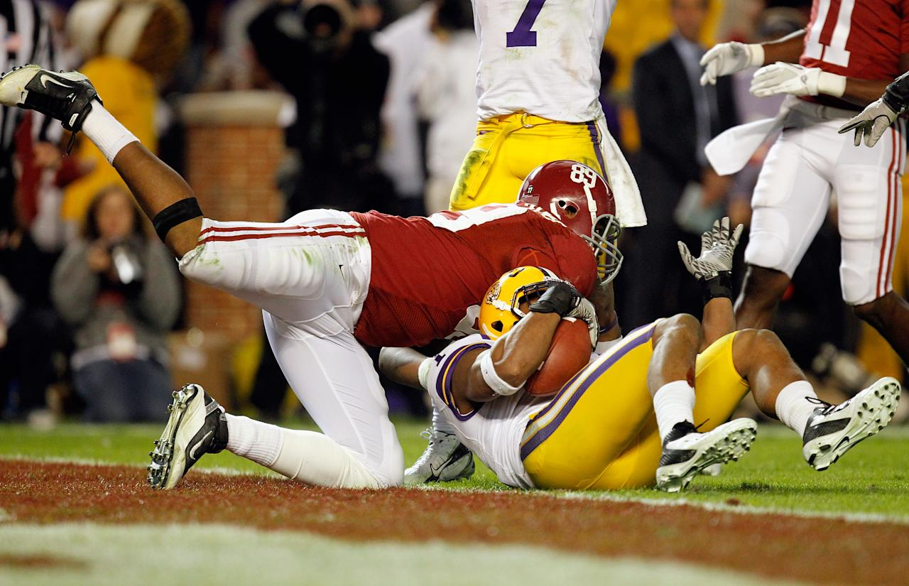 TUSCALOOSA, AL - NOVEMBER 05:  Eric Reid #1 of the LSU Tigers makes a catch over Michael Williams #89 of the Alabama Crimson Tide for an interception during the second half of the game at Bryant-Denny Stadium on November 5, 2011 in Tuscaloosa, Alabama.  (Photo by Streeter Lecka/Getty Images)