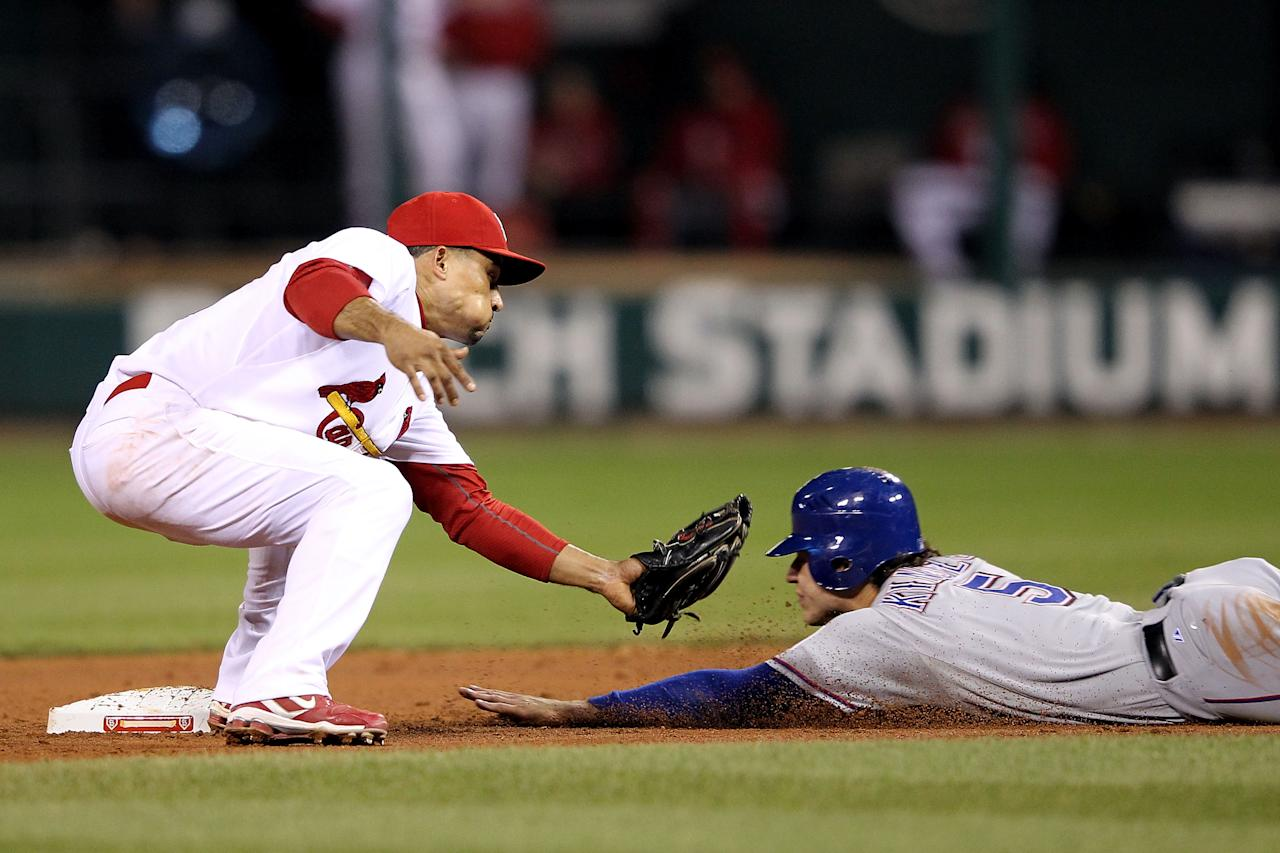 ST LOUIS, MO - OCTOBER 20:  Ian Kinsler #5 of the Texas Rangers steals second base ahead of the tag by Rafael Furcal #15 of the St. Louis Cardinals in the ninth inning during Game Two of the MLB World Series at Busch Stadium on October 20, 2011 in St Louis, Missouri.  (Photo by Jamie Squire/Getty Images)