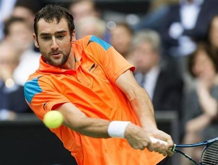 Marin Cilic hits a backhand against Tomas Berdych during their final match the ABN AMRO tennis tournament in Rotterdam
