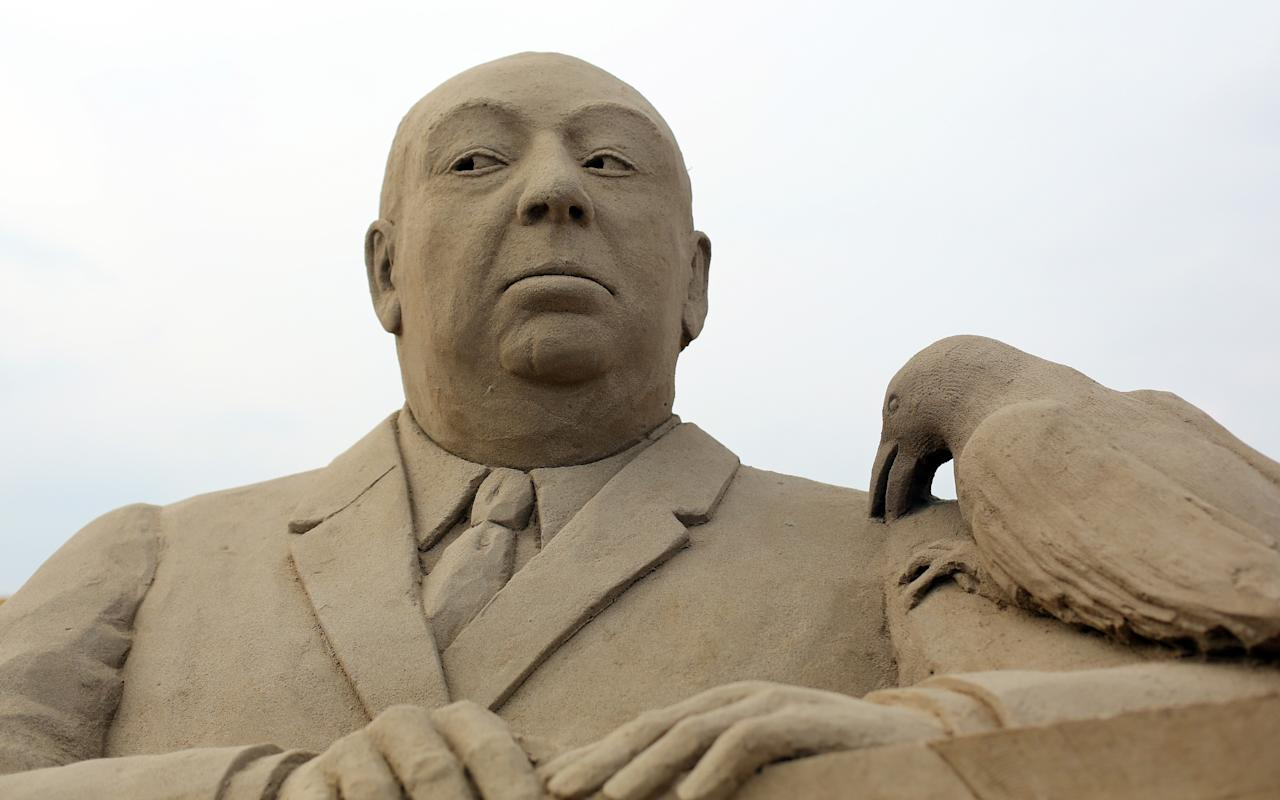 WESTON-SUPER-MARE, ENGLAND - MARCH 26:  Detail of a sand sculpture of Alfred Hitchcock is seen as pieces are prepared as part of this year's Hollywood themed annual Weston-super-Mare Sand Sculpture festival on March 26, 2013 in Weston-Super-Mare, England. Due to open on Good Friday, currently twenty award winning sand sculptors from across the globe are working to create sand sculptures including Harry Potter, Marilyn Monroe and characters from the Star Wars films as part of the town's very own movie themed festival on the beach.  (Photo by Matt Cardy/Getty Images)
