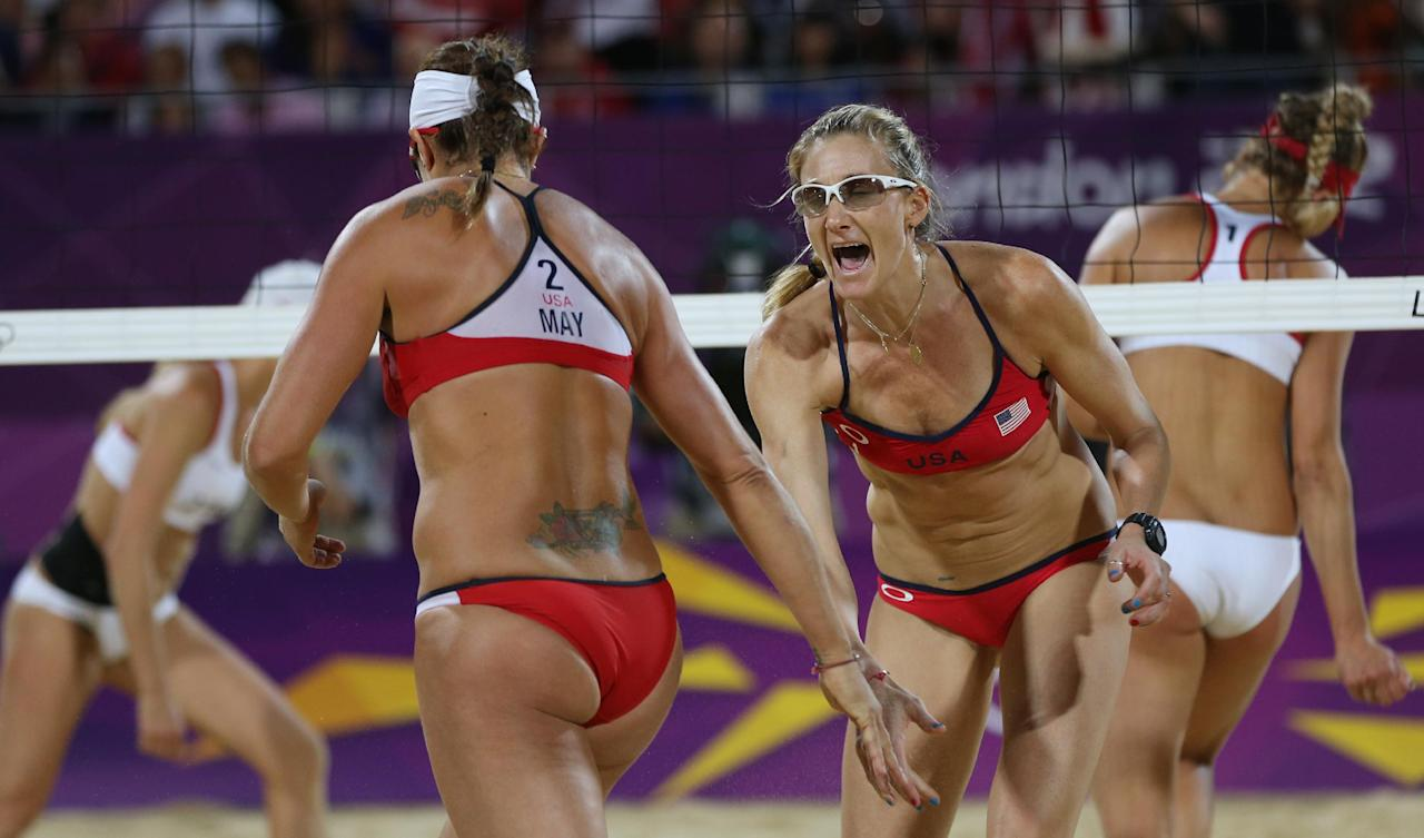 United States' Kerri Walsh Jennings, right, and Misty May-Treanor, left, react during the women's gold medal beach volleyball match against the other US team at the 2012 Summer Olympics, Wednesday, Aug. 8, 2012, in London. (AP Photo/Petr David Josek)
