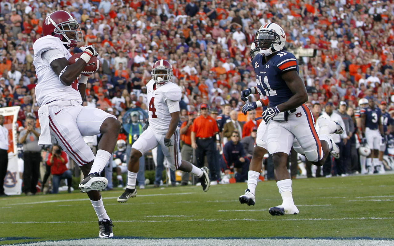 Alabama wide receiver Kenny Bell (7) catches a first-quarter touchdown pass as Auburn cornerback Chris Davis (11) defends during an NCAA college football game at Jordan-Hare Stadium in Auburn, Ala., Saturday, Nov. 26, 2011. (AP Photo/Dave Martin)