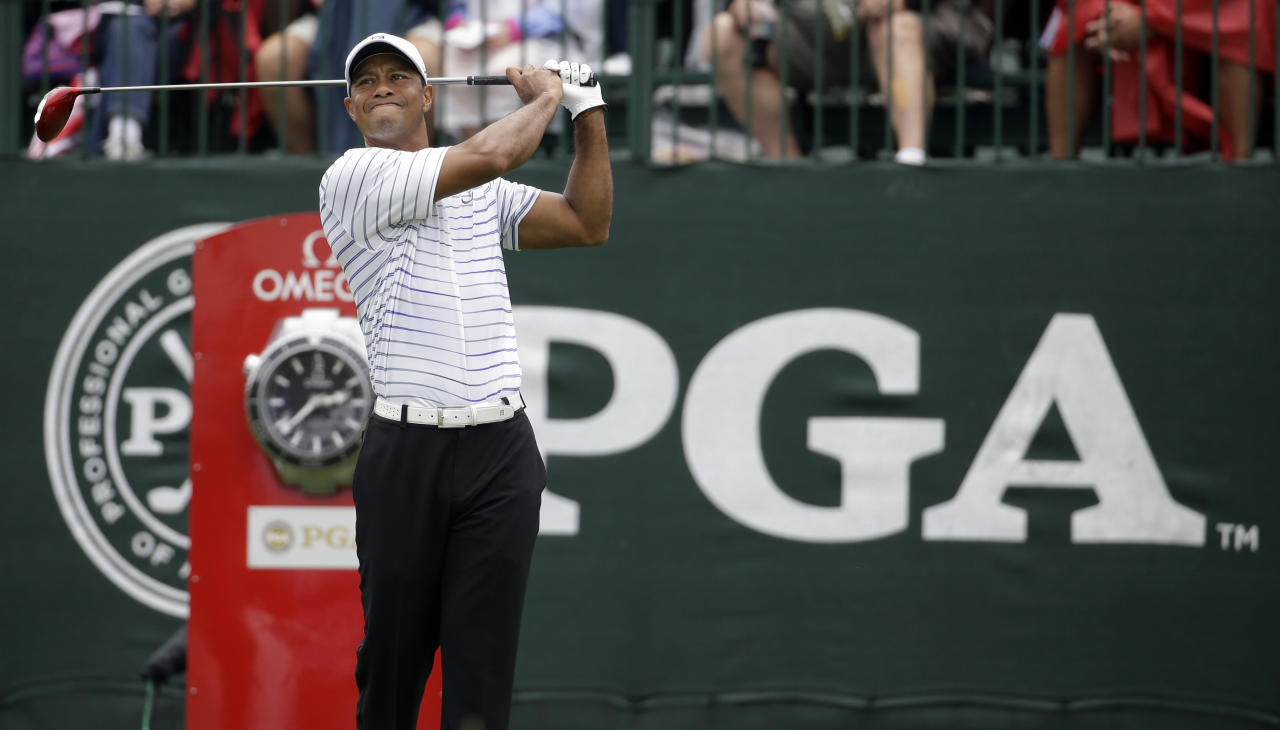 Tiger Woods watches his tee shot on the first hole during the second round of the PGA Championship golf tournament at Valhalla Golf Club on Friday, Aug. 8, 2014, in Louisville, Ky. (AP Photo/Jeff Roberson)