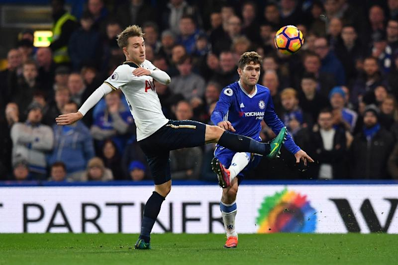 Tottenham Hotspur's midfielder Christian Eriksen (L) vies with Chelsea's defender Marcos Alonso (R) during the English Premier League football match November 26, 2016