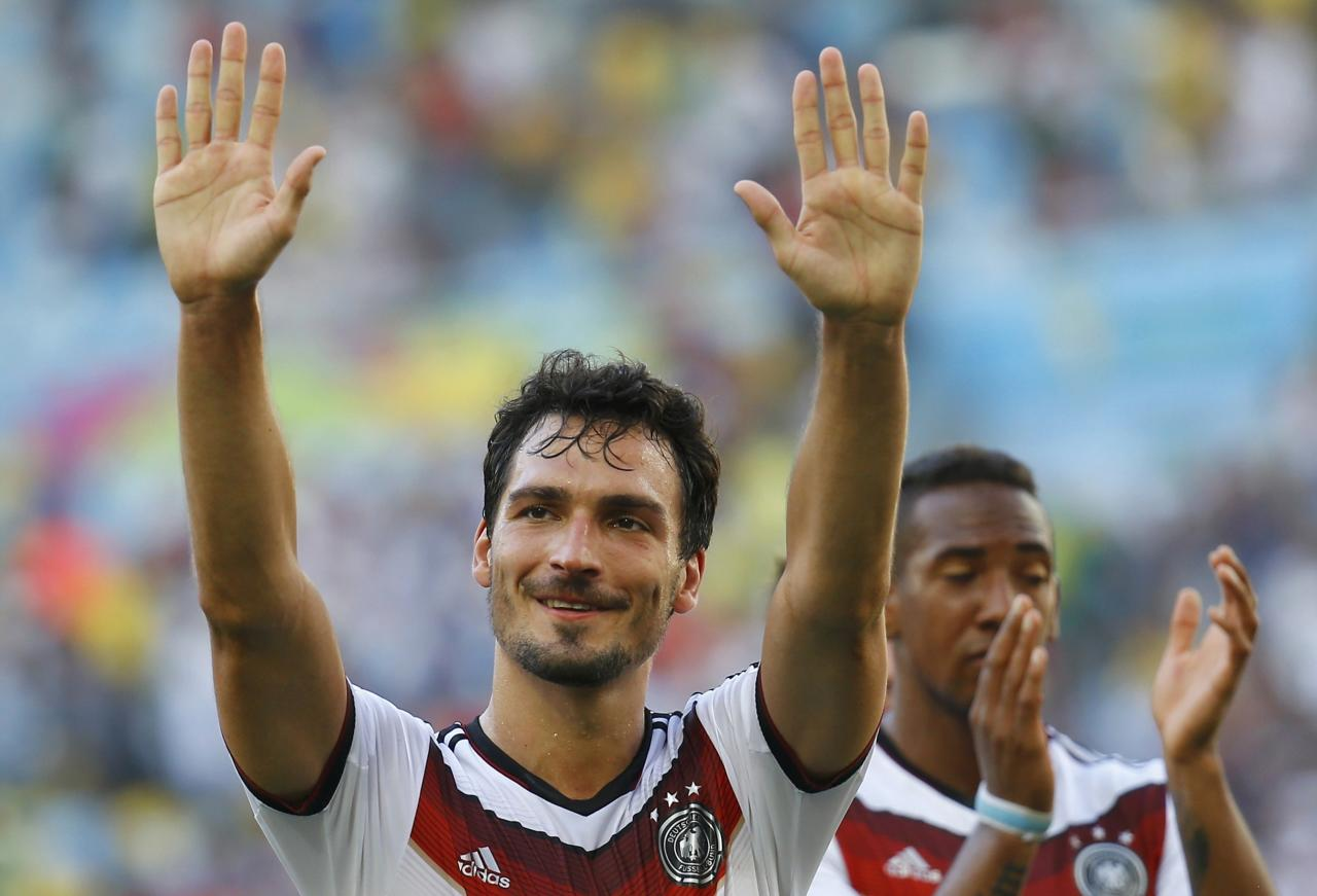 Germany's Mats Hummels gestures in front of teammate Jerome Boateng as they celebrate their win over France after their 2014 World Cup quarter-finals at the Maracana stadium in Rio de Janeiro July 4, 2014. REUTERS/Kai Pfaffenbach (BRAZIL - Tags: SOCCER SPORT WORLD CUP TPX IMAGES OF THE DAY)