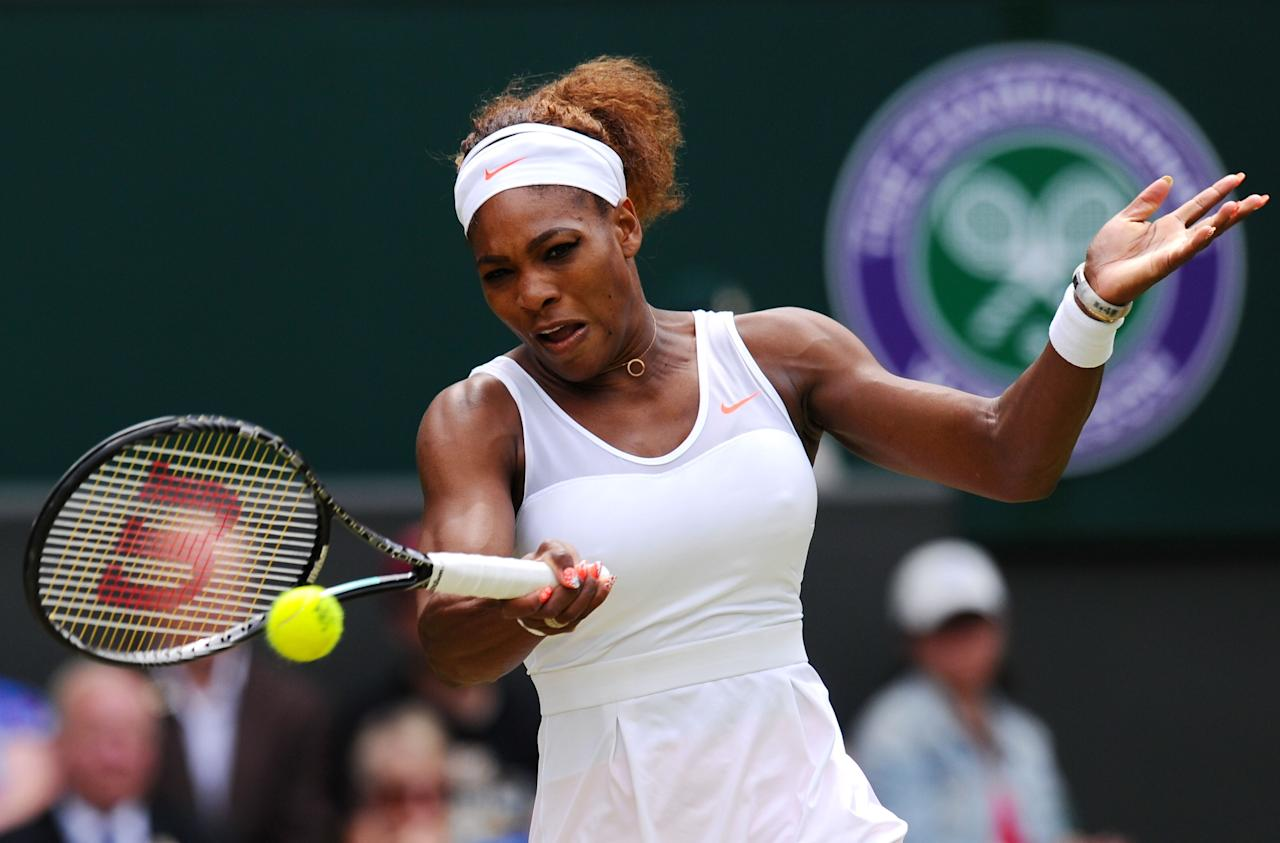 LONDON, ENGLAND - JULY 01: Serena Williams of United States of America plays a forehand during her Ladies' Singles fourth round match against Sabine Lisicki of Germany on day seven of the Wimbledon Lawn Tennis Championships at the All England Lawn Tennis and Croquet Club on July 1, 2013 in London, England. (Photo by Mike Hewitt/Getty Images)