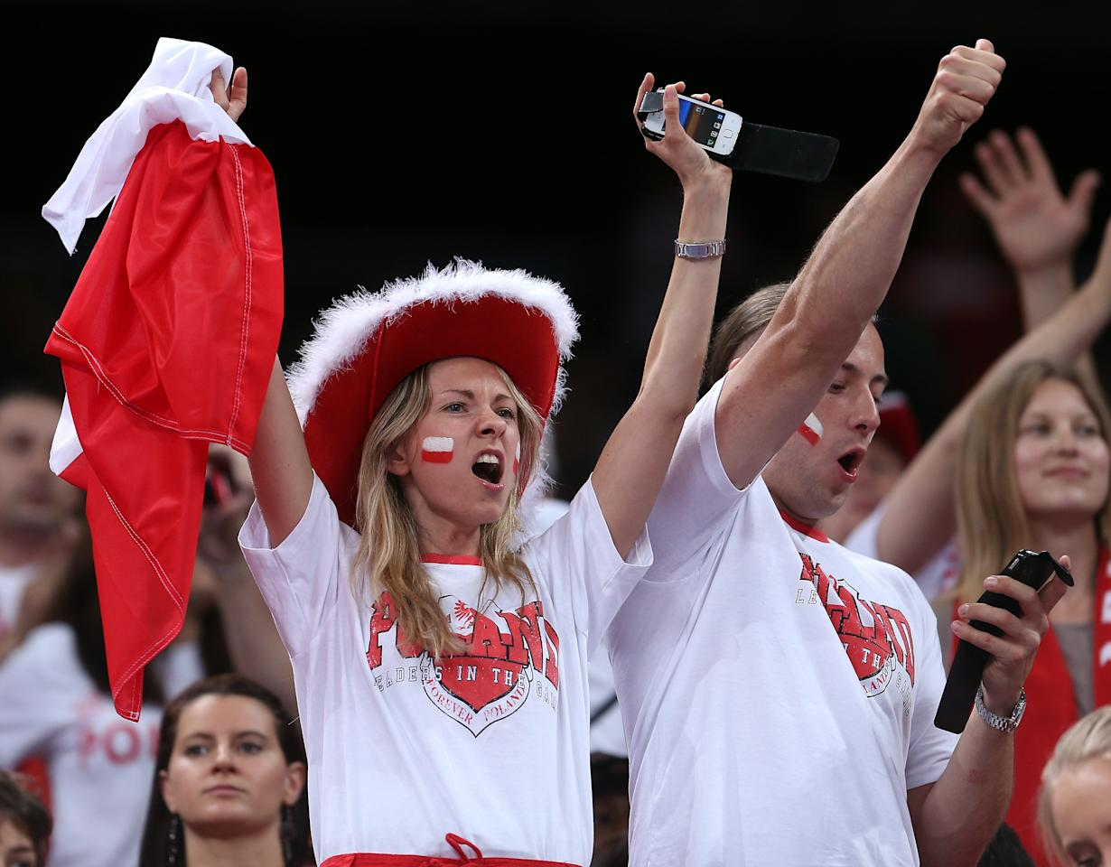 LONDON, ENGLAND - JULY 29:  Poland fans cheer on their team as they take on Italy during Men's Volleyball on Day 2 of the London 2012 Olympic Games at Earls Court on July 29, 2012 in London, England.  (Photo by Elsa/Getty Images)