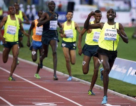 Kiplagat of Kenia celebrates as he crosses the finish line in the men's 1500m event during during the Golden Gala IAAF Diamond League at the Olympic stadium in Rome