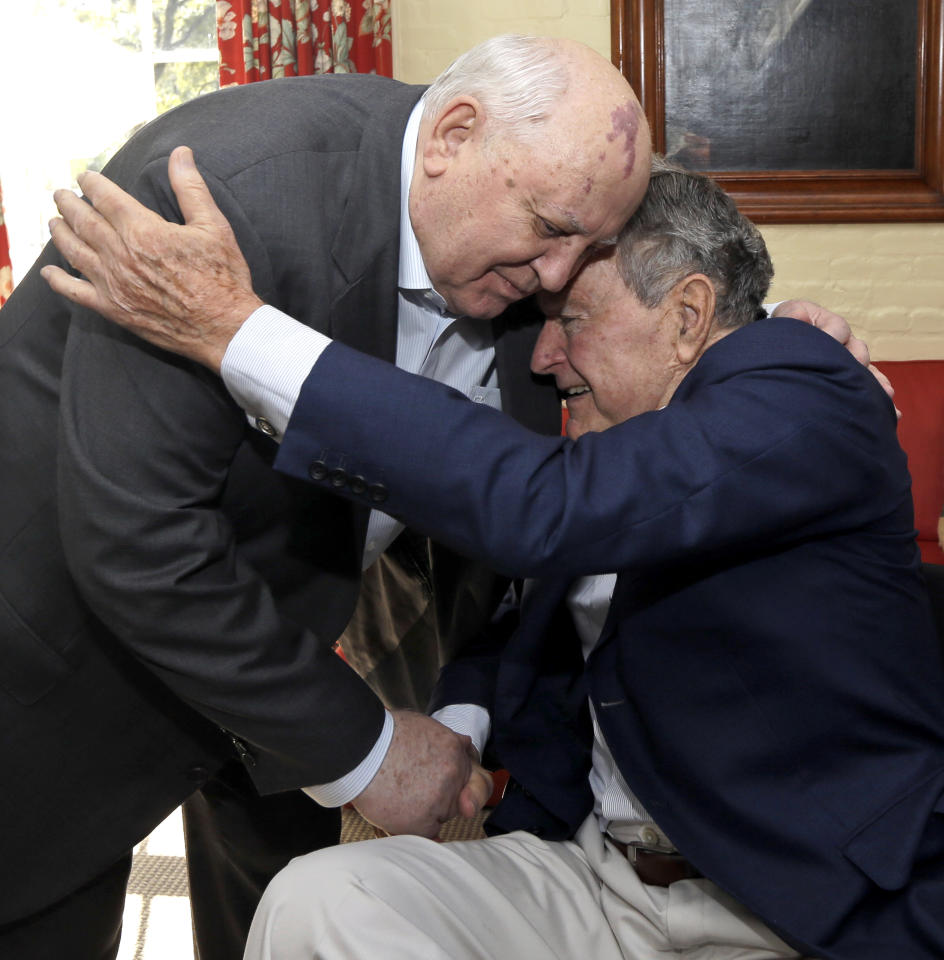 Former President of the Soviet Union Mikhail Gorbachev, left, is greeted by former President George H.W. Bush, right, as the two meet for lunch Thursday, Nov. 1, 2012, in Houston. Gorbachev is in Houston to speak at the Brilliant Lecture Series. (AP Photo/David J. Phillip)