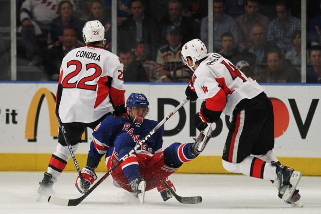 NEW YORK, NY - APRIL 26:  Marian Gaborik #10 of the New York Rangers falls to the ice against the defense of Erik Condra #22 and Chris Phillips #4 of the Ottawa Senators in the third period of Game Seven of the Eastern Conference Quarterfinals during the 2012 NHL Stanley Cup Playoffs at Madison Square Garden on April 26, 2012 in New York City.  (Photo by Bruce Bennett/Getty Images)