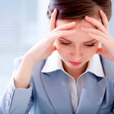 Tired-businessman-head-in-hands-blue-suit_web