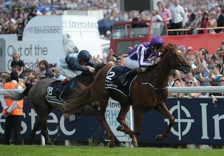 Joseph O'Brien rides Australia (R) to victory in the Derby on Derby Day during the Epsom Derby Festival, in Surrey, on June 7, 2014