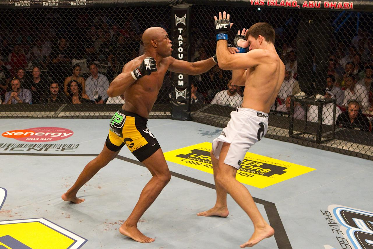 ABU DHABI, UNITED ARAB EMIRATES - APRIL 10: Anderson Silva (black/yellow) def. Demian Maia (white shorts) - Unanimous Decision during UFC 112 at Yas Island on April 10, 2010 in Abu Dhabi, United Arab Emirates. (Photo by Josh Hedges/Zuffa LLC via Getty Images)