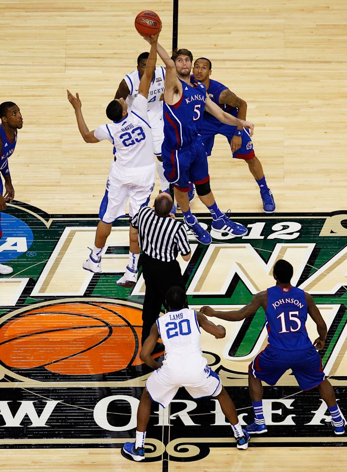 Jeff Withey #5 of the Kansas Jayhawks and Anthony Davis #23 of the Kentucky Wildcats tip the ball off to start the National Championship Game of the 2012 NCAA Division I Men's Basketball Tournament at the Mercedes-Benz Superdome on April 2, 2012 in New Orleans, Louisiana. (Photo by Chris Graythen/Getty Images)