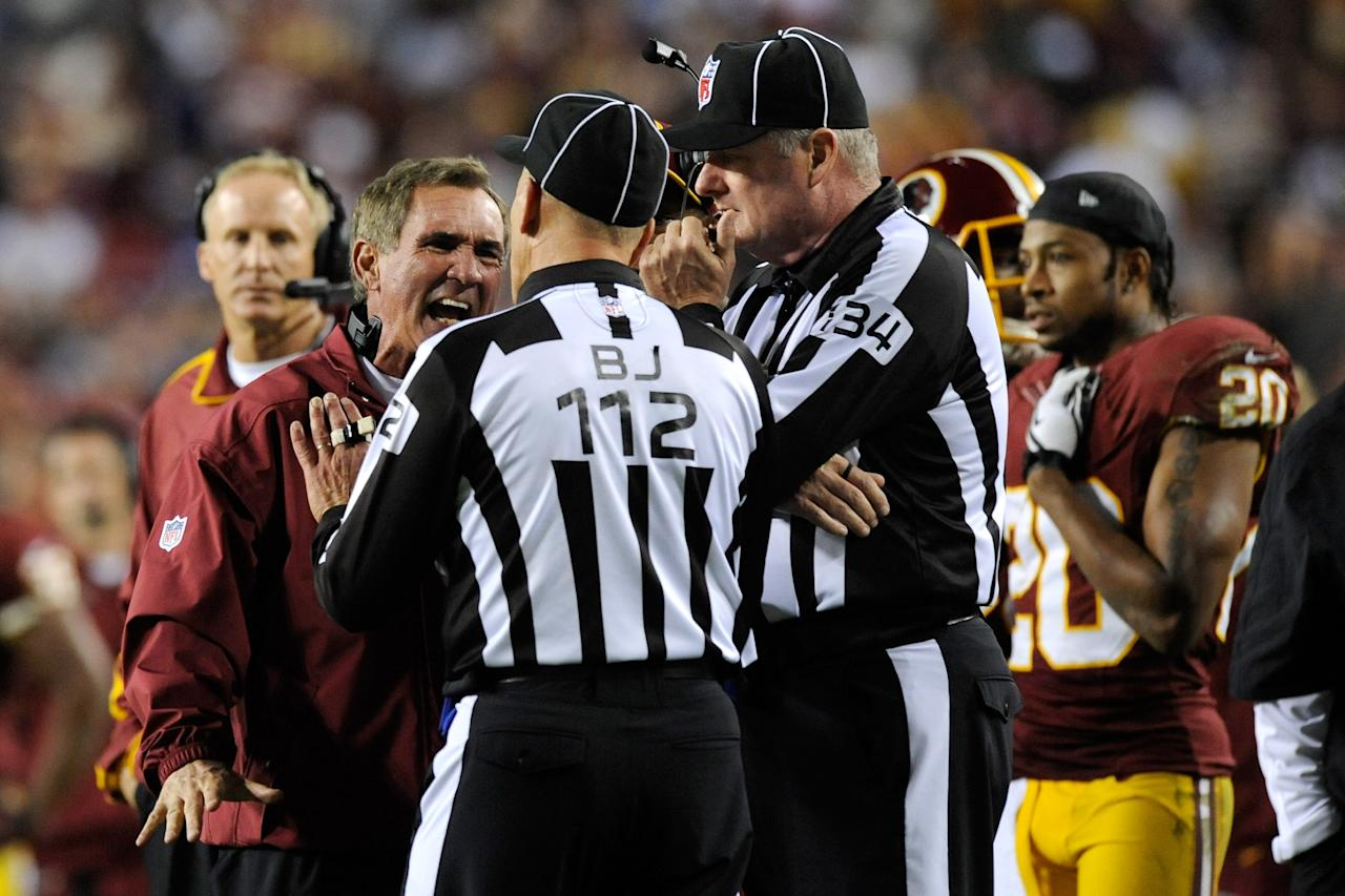 LANDOVER, MD - DECEMBER 03:  Head coach Mike Shanahan of the Washington Redskins yells at back judge Tony Steratore #112 in the third quarter while taking on the New York Giants at FedExField on December 3, 2012 in Landover, Maryland.  (Photo by Patrick McDermott/Getty Images)