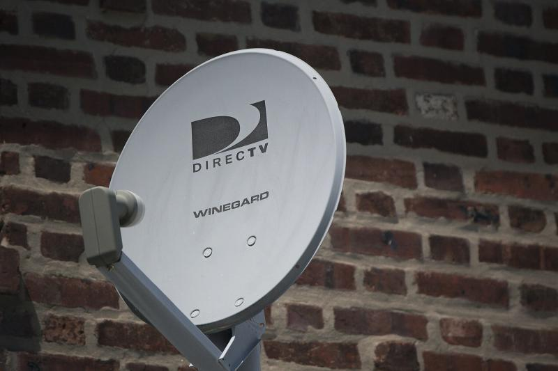 File photo of a DirecTV dish outside a home in the Queens borough of New York