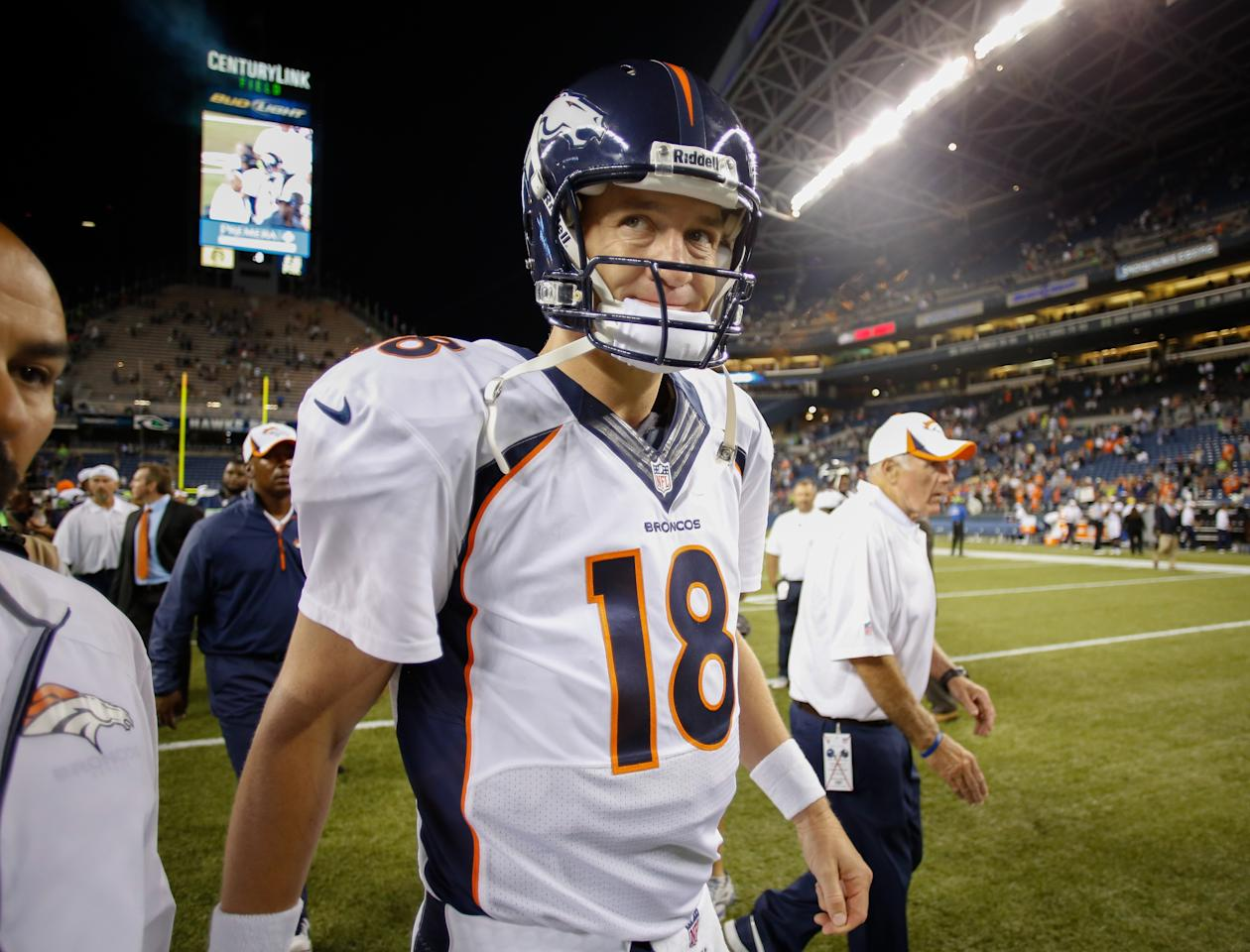 SEATTLE, WA - AUGUST 17: Quarterback Peyton Manning #18 of the Denver Broncos walks off the field after being defeated by the Seattle Seahawks 40-10 at CenturyLink Field on August 17, 2013 in Seattle, Washington. (Photo by Otto Greule Jr/Getty Images)