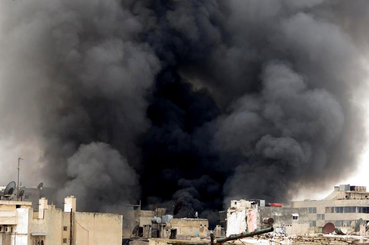 In this Tuesday March 19, 2013, citizen journalism image provided by Aleppo Media Center AMC which has been authenticated based on its contents and other AP reporting, black smoke rise from buildings due to government forces shelling, in Aleppo, Syria. Syria's main opposition group demanded Wednesday a full international investigation into an alleged chemical weapons attack in the country's north, calling for a team to be sent to the village where it reportedly occurred. (AP Photo/Aleppo Media Center, AMC)