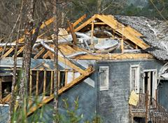 House with destroyed roof