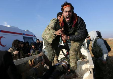 A Free Syrian Army fighter reacts as he mourns near the body of his brother, who was an FSA fighter and died during an offensive against Islamic State fighters to take control of Qabasin town, on the outskirts of the northern Syrian town of al-Bab